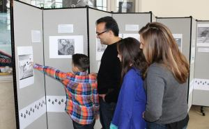 Big Read Dearborn photo - Kickoff - Sareini family viewing artwork display