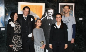 Council President Susan Dabaja and her daughter, Joël, take a picture with Poe era couple, Poe, and library staff member Henry Fischer