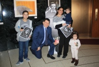 Superintendent Glenn Maleyko with a family celebrating Poe