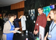Library staff members Jim Knapp and Nicki Goran with FOLD member Carolyn Cicero at T-shirt and Poe House draw slips Table