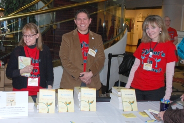 Welcome Table (left to right): Joan Martin, Adam Cloutier, and Julie Schaefer