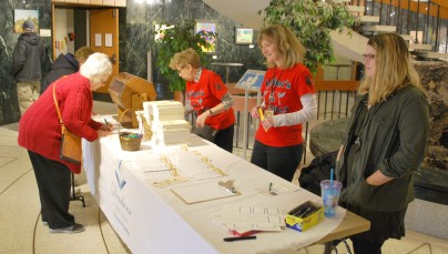 Welcome Table (l.-r.: Maryanne Bartles, Julie Schaefer, and Nicole Wandolowski)
